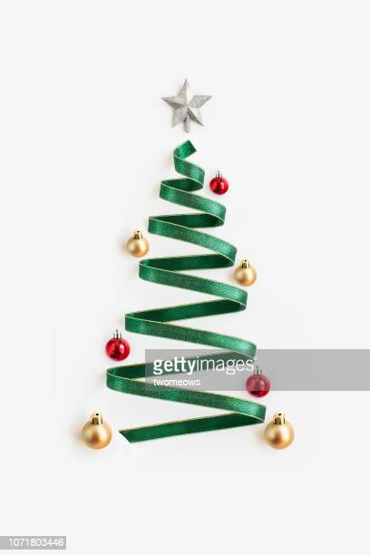 conceptual christmas tree decoration still life. - christmas still life stock pictures, royalty-free photos & images