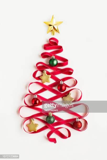 conceptual christmas tree decoration still life. - símbolo - fotografias e filmes do acervo