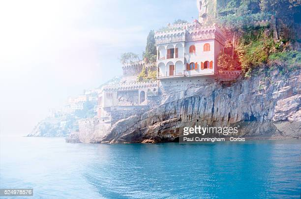 Conceptual Cliff edged villas along the Amalfi rocky coastline viewed from the water Italy 23 May 2009 Image by �� Paul Cunningham/Corbis
