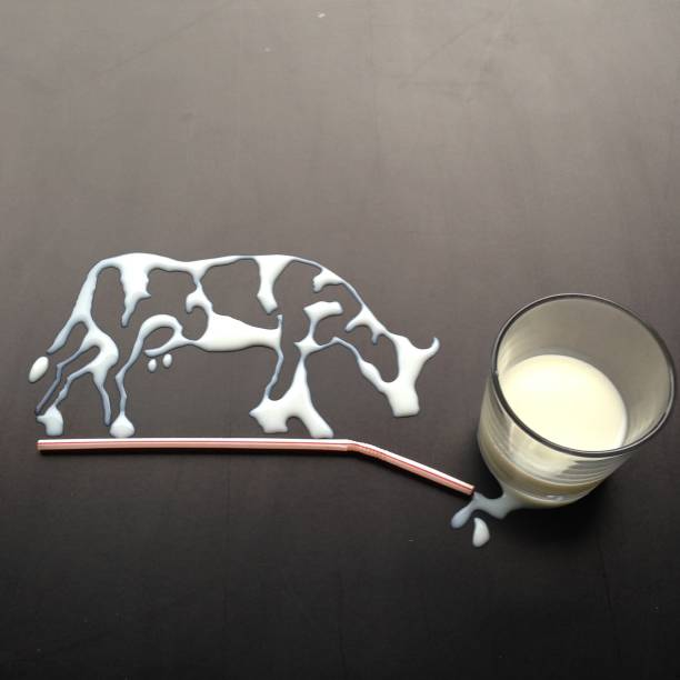 conceptual cow made from milk - cow milk stock pictures, royalty-free photos & images