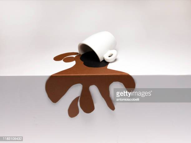 conceptual cup of spilled coffee on a table - mixed media stock pictures, royalty-free photos & images