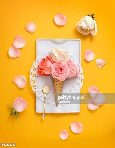 conceptual dessert still life shot. - comida flores fotografías e imágenes de stock