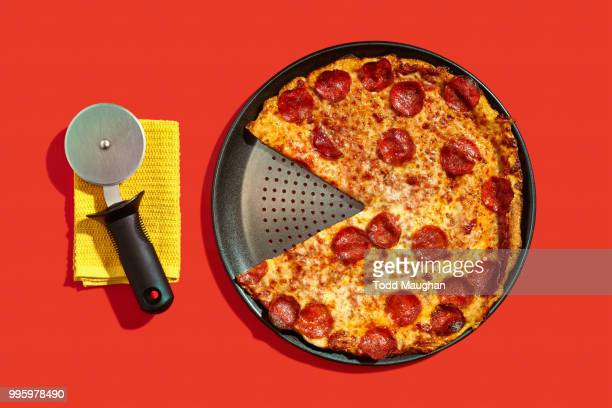 conceptual food - pepperoni pizza stock photos and pictures