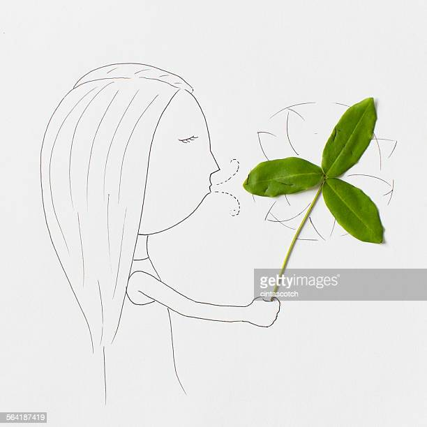 conceptual girl blowing a pinwheel - mixed media stock pictures, royalty-free photos & images