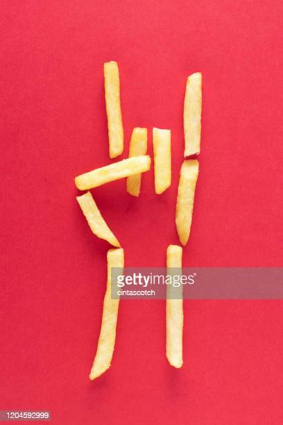 conceptual hang loose sign - french fries stock pictures, royalty-free photos & images