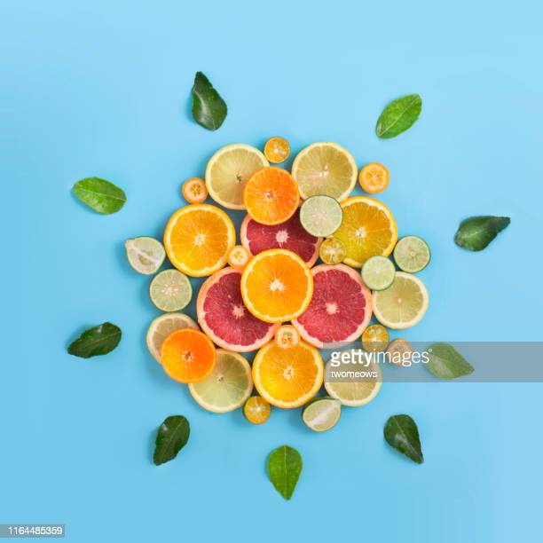 conceptual healthy citrus fruits eating still life image. - zitrusfrucht stock-fotos und bilder