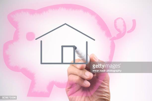 Conceptual image for piggy bank with real estate