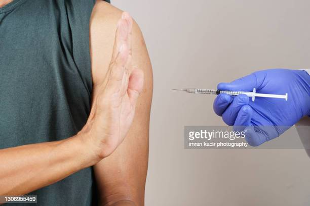 conceptual image for vaccine rejection - anti vaccination stock pictures, royalty-free photos & images