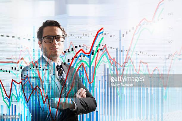Conceptual image of businessman with graph data