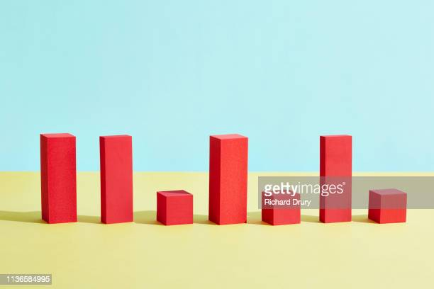 conceptual image of geometric blocks - bar graph stock pictures, royalty-free photos & images