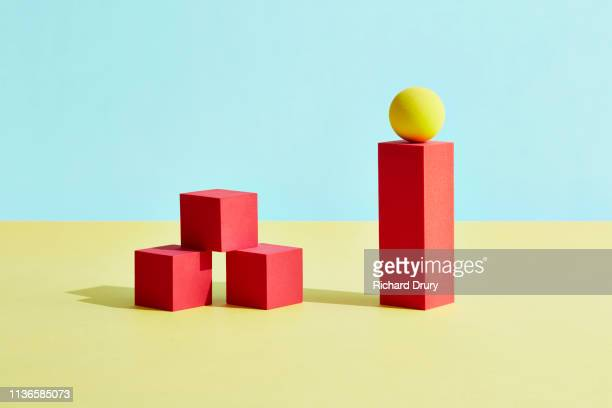 conceptual image of geometric blocks - cube stock pictures, royalty-free photos & images