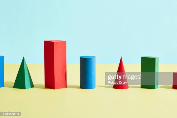 conceptual image of geometric blocks - cone shape stock pictures, royalty-free photos & images
