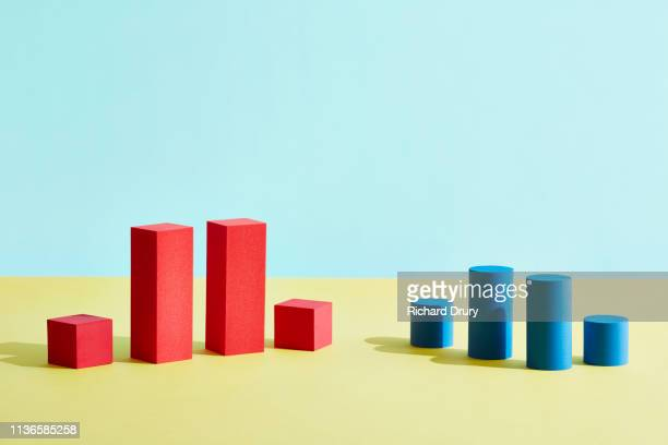 conceptual image of geometric blocks - comparison stock pictures, royalty-free photos & images