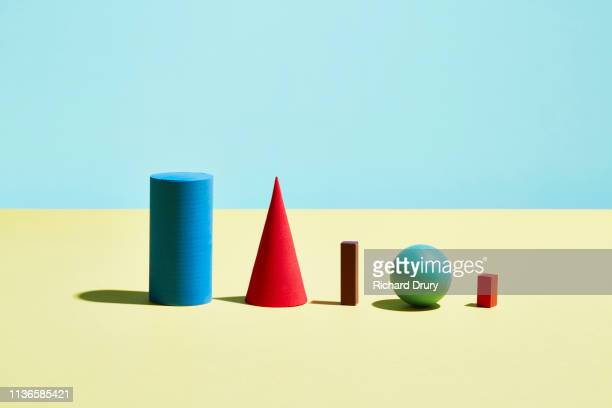 conceptual image of geometric blocks - cylinder stock pictures, royalty-free photos & images