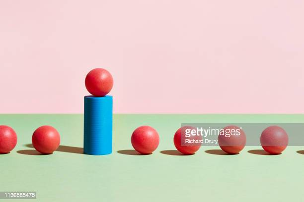 conceptual image of geometric blocks - red tube top stock pictures, royalty-free photos & images