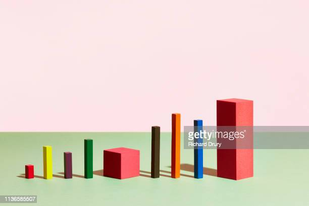 conceptual image of geometric blocks - onward stock pictures, royalty-free photos & images