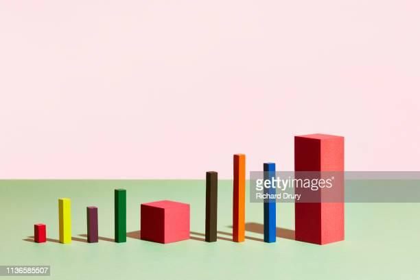 conceptual image of geometric blocks - balkendiagramm stock-fotos und bilder