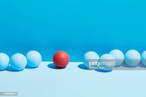 conceptual image of geometric blocks - individualidad fotografías e imágenes de stock