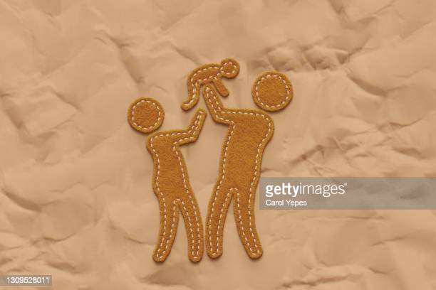 conceptual image of happy family with one child made in felt - mortgage stock pictures, royalty-free photos & images