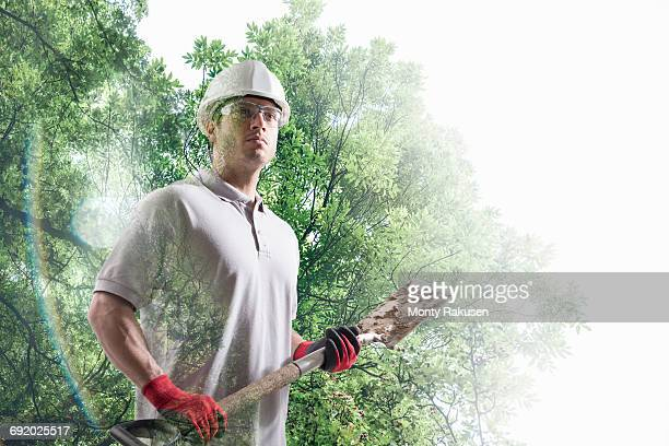 Conceptual image of workman holding spade