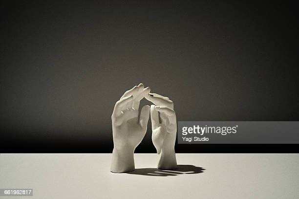 conceptual image / white hand of sculpture - sculpture stock pictures, royalty-free photos & images