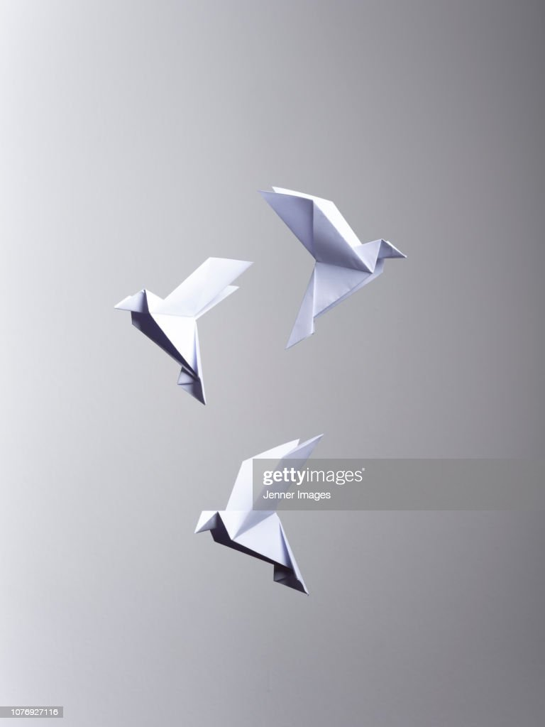 Conceptual Nature - 3 White Origami Birds flying. : Stock Photo