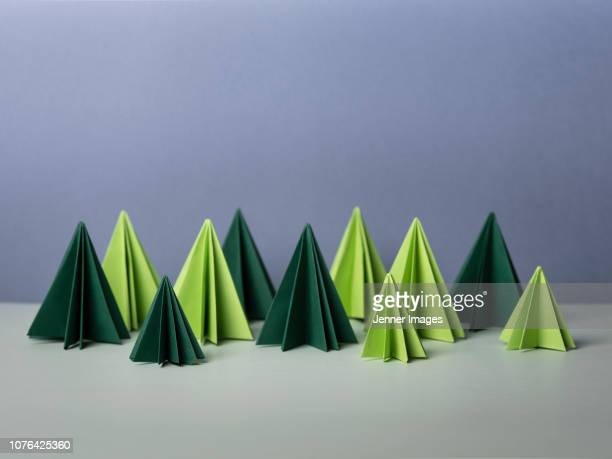 conceptual nature - origami forest of fir tree's. - origami photos et images de collection