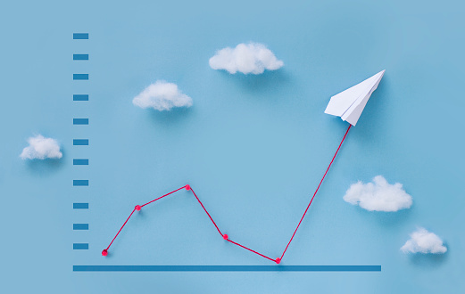 Conceptual paper plane pulling business finance growth chart still life image. 1091245836