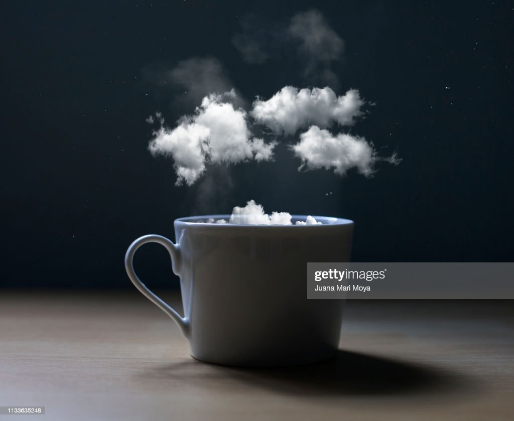 Conceptual photo of a cup with clouds : Stock Photo