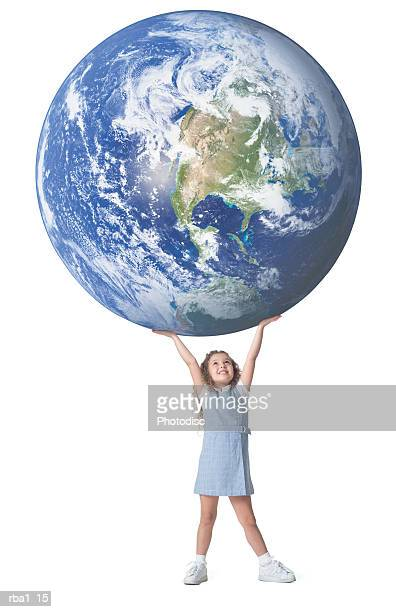 conceptual photo of a little caucasian girl as she holds a giant earth above her head
