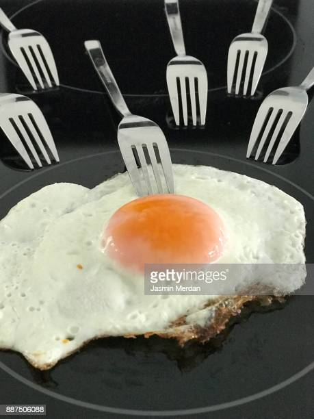 Conceptual photo of egg and forks symbolizing insemination