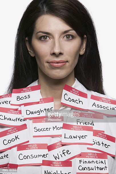 conceptual portrait of a young adult woman who is covered in various labels and titles
