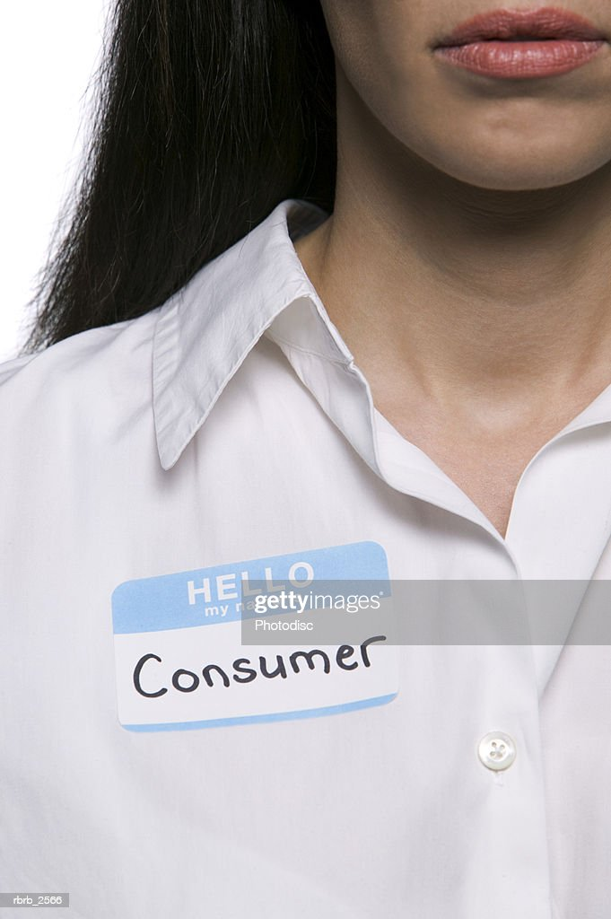 conceptual portrait of an adult woman wearing a name tag stating she is a consumer : Foto de stock