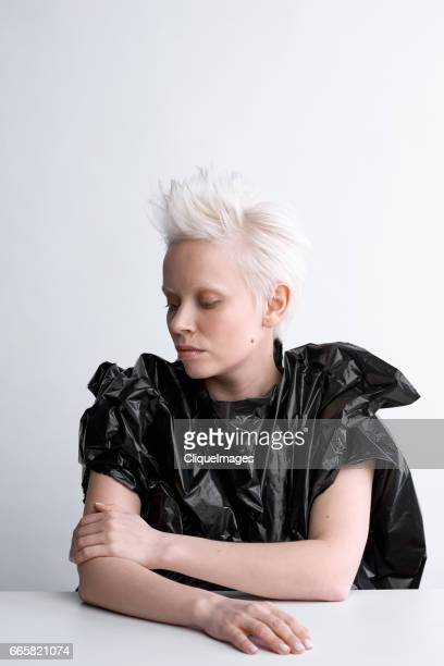 conceptual portrait of blond-haired woman - cliqueimages fotografías e imágenes de stock