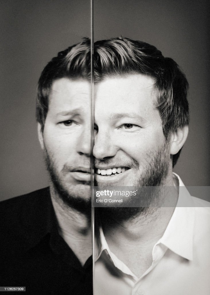 Conceptual portrait of man, reflected in many mirrors, changing emotion from happy to sad : Stock Photo