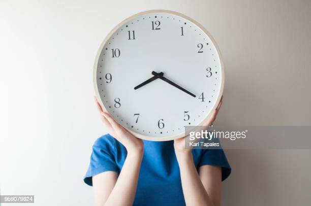 a conceptual realism of time - clock face stock pictures, royalty-free photos & images