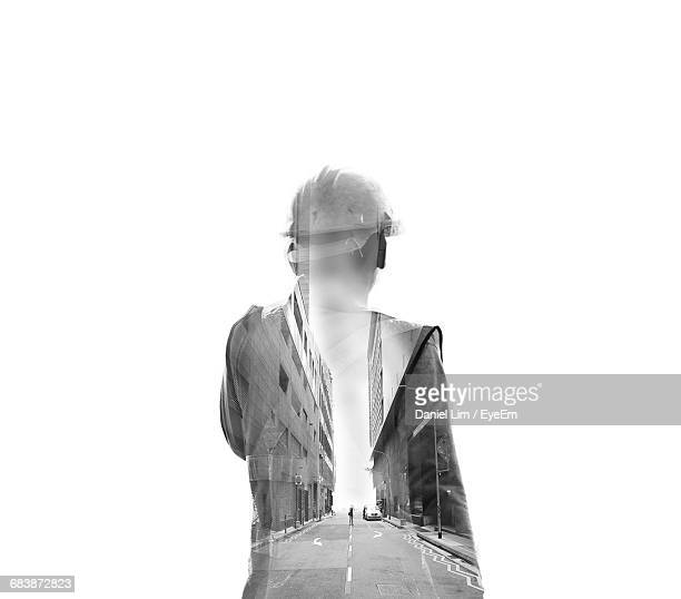 conceptual rear view of a man with hardhat - rear view photos stock photos and pictures