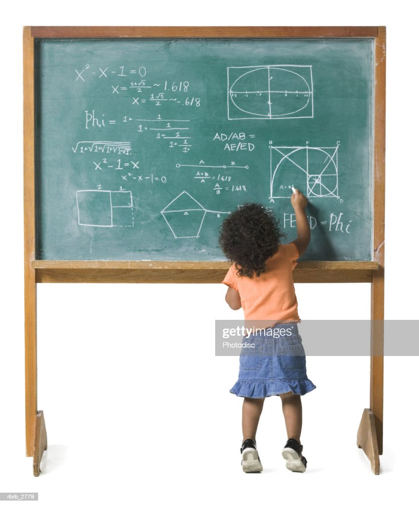 conceptual shot of a young female child as she works out a problem on a chalkboard : Foto de stock