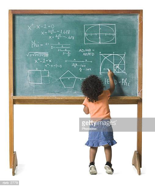 conceptual shot of a young female child as she works out a problem on a chalkboard - stereotypical stock pictures, royalty-free photos & images