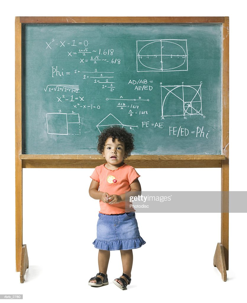 conceptual shot of a young female child in front of a problem on a chalkboard : Stockfoto