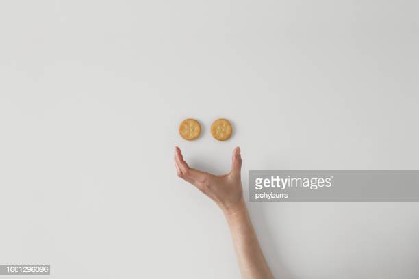 conceptual smiley face - cracker snack stock photos and pictures
