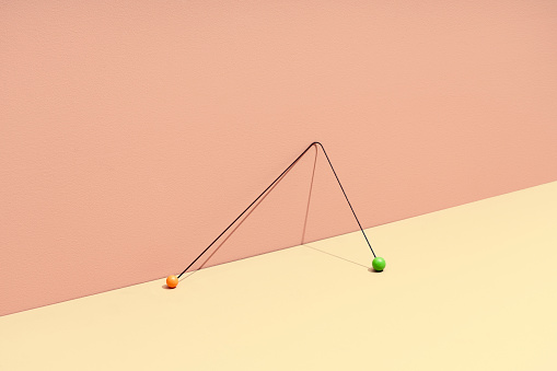 Conceptual still life with stick and colored marbles - gettyimageskorea