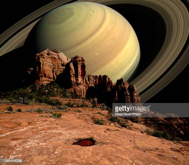 conceptual view of saturn rising behind cathedral rock, sedona, arizona, usa - extreme terrain stock pictures, royalty-free photos & images