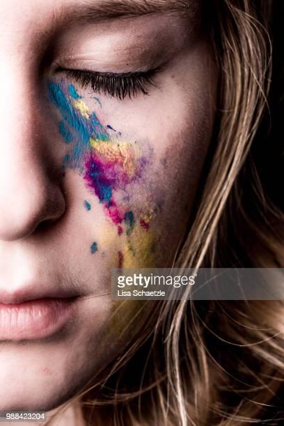 conceptual: woman crying colourful tears - darstellender künstler stock-fotos und bilder
