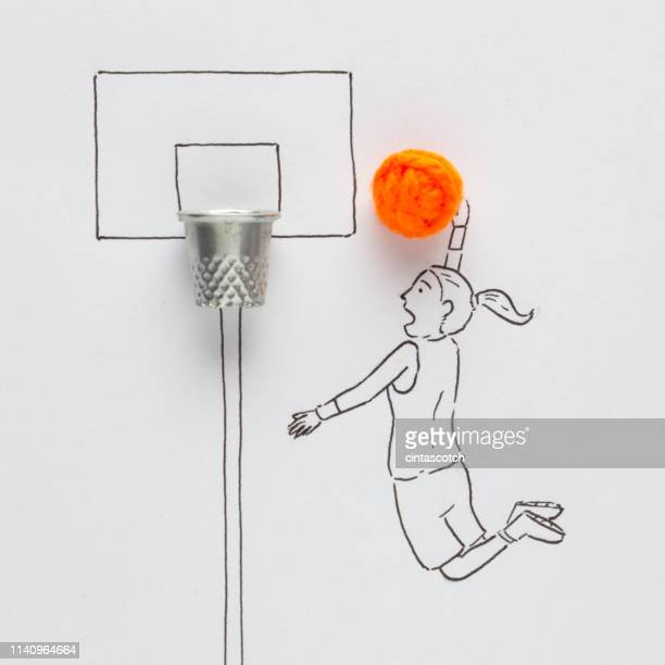 conceptual woman playing basketball - encestar fotografías e imágenes de stock