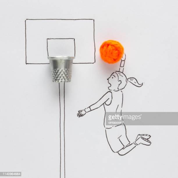 conceptual woman playing basketball - korb werfen stock-fotos und bilder