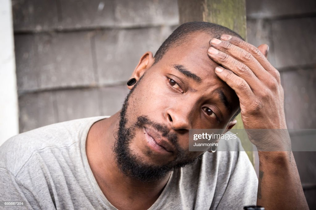concerned afro caribbean man : Stock Photo
