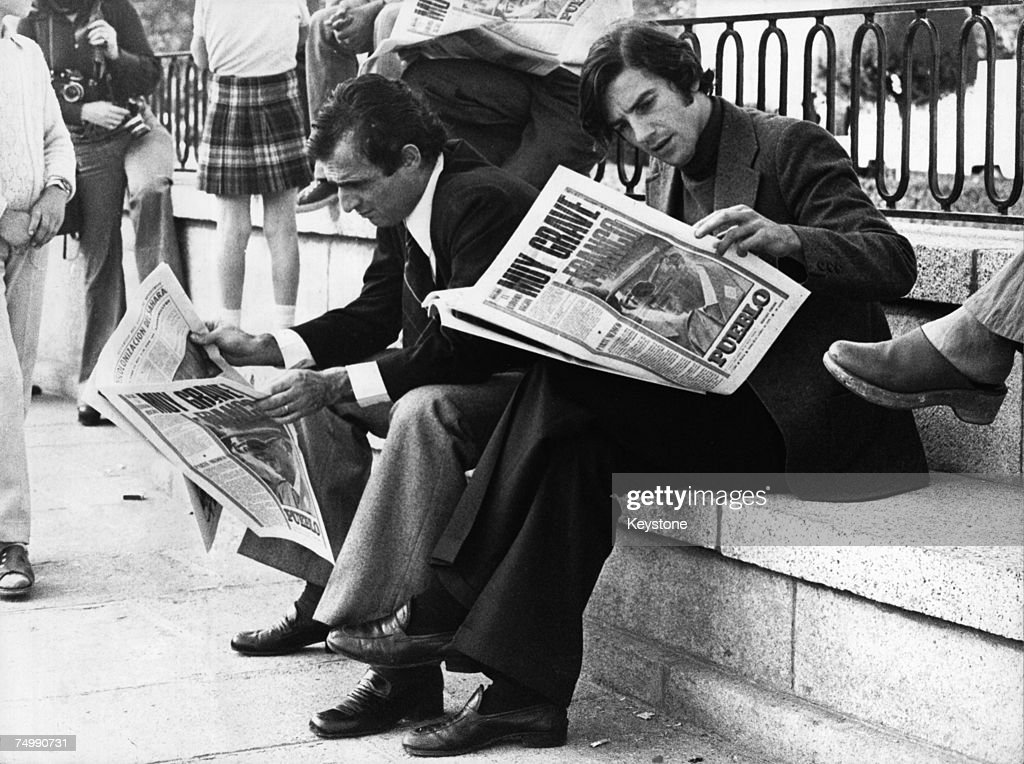 Concerned citizens read news of General Francisco Franco's worsening illness outside El Pardo Palace, the Generalissimo's residence near Madrid, 29th October 1975.