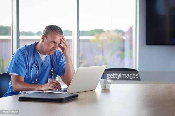 concerned doctor in hospital meeting room