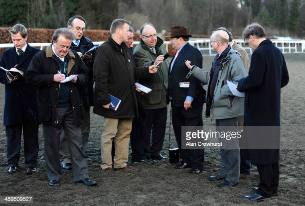 Concerned looking Nicky Henderson chats with the press after Sprinter Sacre was pulled up in The williamhill.com Desert Orchid Steeple Chase at...
